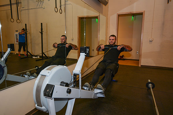 man using a rower